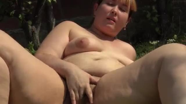 A fat girl smokes and shows her hairy pussy and a fat ass