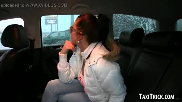 Sultry amateur brunette sucking cock in a taxi