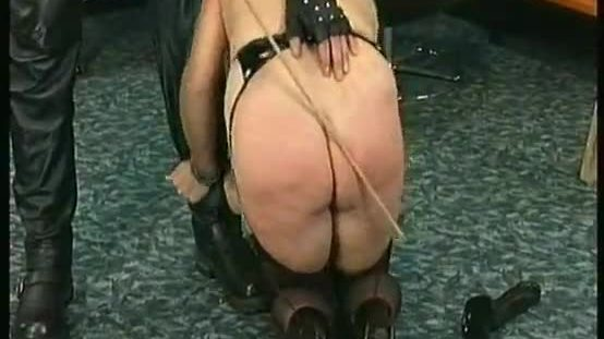 Masked milf slave fucked with a large black and spanked with wooden stick on her ass